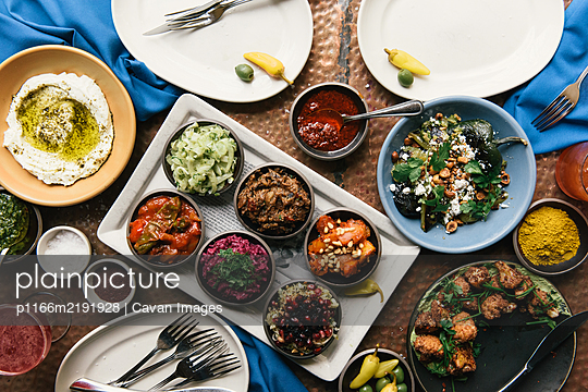 Grand buffet of traditional Israeli foods at fine dining restaurant - p1166m2191928 by Cavan Images