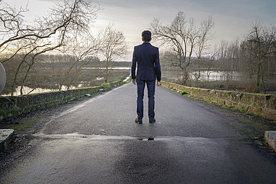 Man on a bridge - p1402m2148312 by Jerome Paressant
