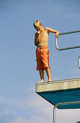 Boy on diving board - p0210274 by Siegfried Kuttig