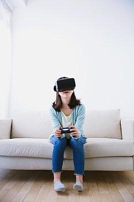 Japanese woman using virtual reality device - p307m1125592f by Yosuke Tanaka