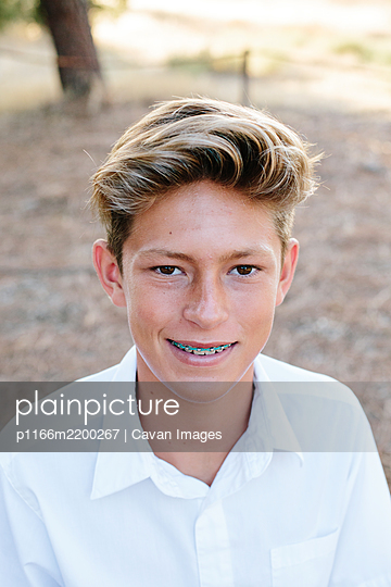Portrait Of A Handsome Teen Boy With Brown Eyes And Braces - p1166m2200267 by Cavan Images