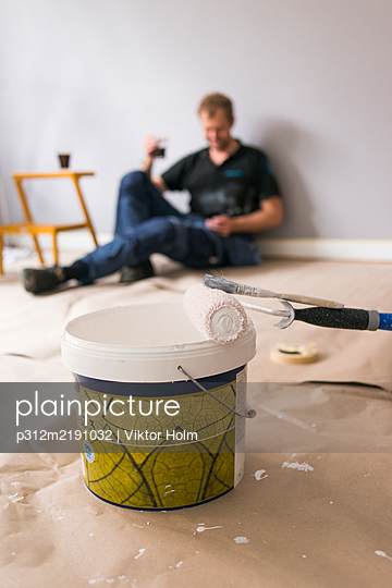Paint roller and paint bucket in room - p312m2191032 by Viktor Holm
