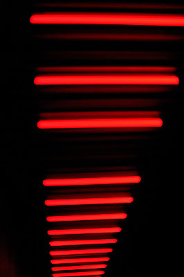 Red stripes of fluorescent lighting - p1047m789482 by Sally Mundy