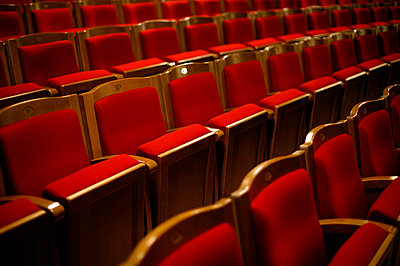 Rows of red theatre seats - p388m877236 by L.B.Jeffries