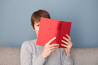 Woman with a red book - p4540849 by Lubitz + Dorner