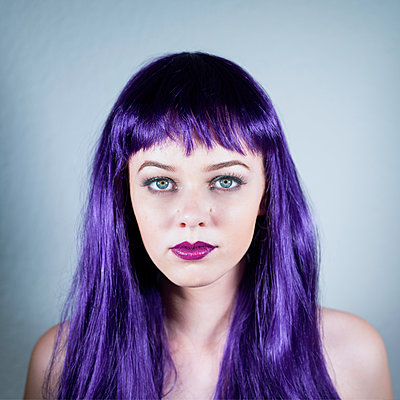 Portrait of woman with long purple hair - p1569m2195808 by Moritz Metzger