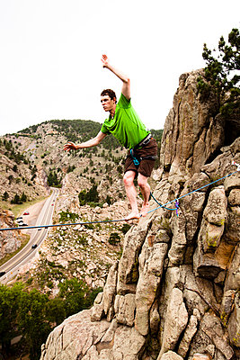 A male highliner walks the Elephant Buttresses highline in Boulder Canyon - p343m801179f by Kyle Sparks