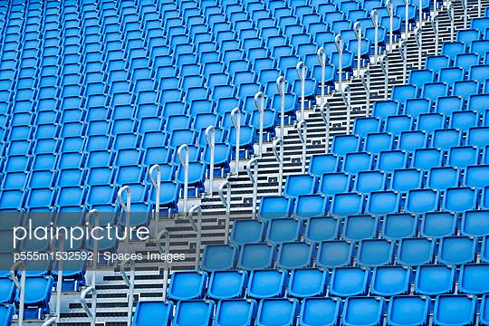 plainpicture | Photo library for authentic images - plainpicture p555m1532592 - Blue seats in stadium - plainpicture/Blend Images/Spaces Images