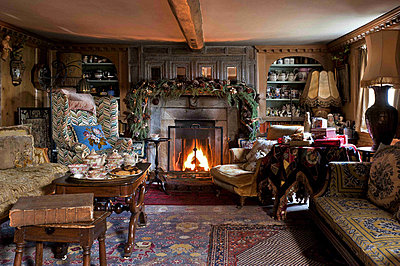 Lit fire in drawing room of Cheltenham country home - p349m790916 by Polly Eltes