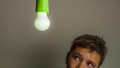 Looking At lightbulb - p1082m2013358 by Daniel Allan