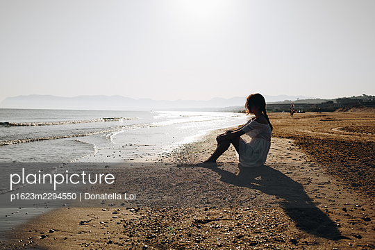 Lonely girl on the beach - p1623m2294550 by Donatella Loi