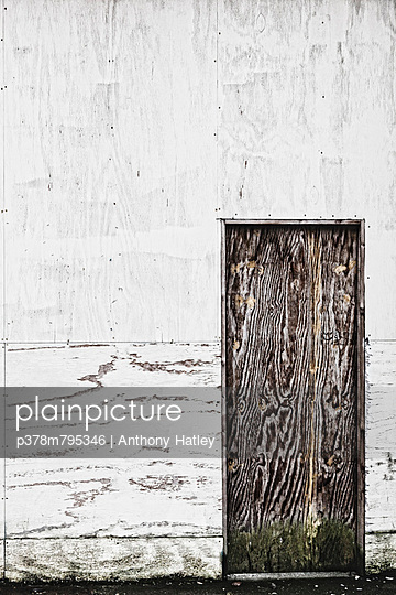 Door in white wall - p378m795346 by Anthony Hatley