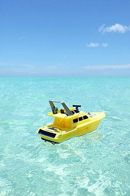 Yellow miniature boat - p045m702557 by Jasmin Sander