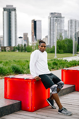 Portrait confident male runner in urban park - p1192m2109998 by Hero Images