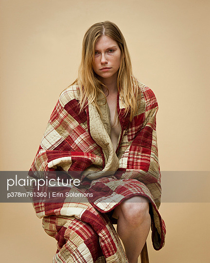 Woman wrapped in quilt - p378m761360 by Erin Solomons