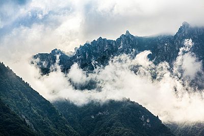 Clouds in the mountains - p1234m1044569 by mathias janke