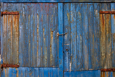 The Side Of A Weathered Building Painted Blue; Argyll Scotland - p442m700412 by John Short