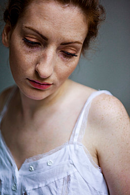 Woman with freckles - p4130663 by Tuomas Marttila