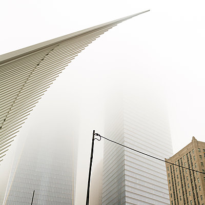 One World trade center in the fog, New York - p1542m2203502 by Roger Grasas