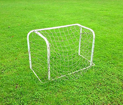 Small goal on football pitch - p1401m2260652 by Jens Goldbeck