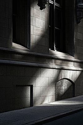 Shadowed building facade - p301m960785f by Michael Mann