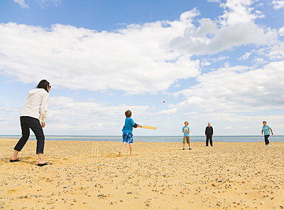 People playing Cricket on a beach - p4297177f by Ashley Jouhar