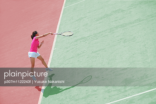 Young Japanese tennis player in action