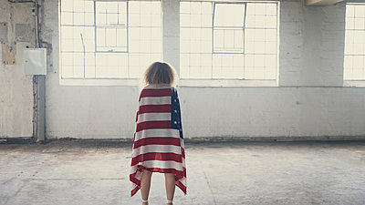 Young woman inside an empty warehouse - p1315m2130405 by Wavebreak