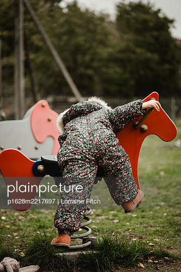 Little girl on playground - p1628m2217697 by Lorraine Fitch