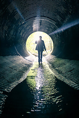 Detective in Tunnel with Water - p1019m1477050 by Stephen Carroll