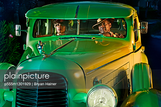 Couple in green vintage car - p555m1301929 by Bryan Hainer