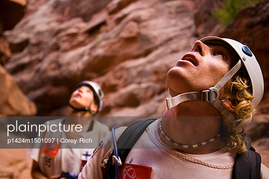 Adventure racers looking up from a canyon after rappelling in a race in Moab, Utah.