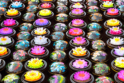 Carved soap lotus flowers in bowls - p555m1219652 by Spaces Images