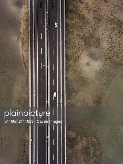 Aerial view of bridge in the sea - p1166m2111829 by Cavan Images