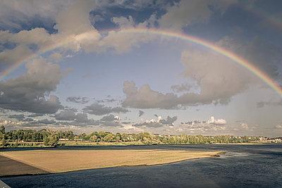Rainbow over Saumur, France - p1402m2206205 by Jerome Paressant