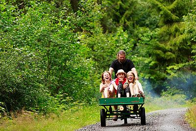 Happy girls having ride on cargo bike - p312m2237198 by Phia Bergdahl
