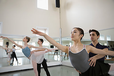Male and female ballet dancers practicing in dance studio - p1192m1403475 by Hero Images