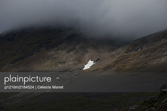 Small snowfield on mountain slope - p1216m2184524 by Céleste Manet