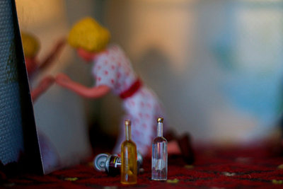 Woman (doll) drunk and unhappy - p1072m857576 by Sarah Smith