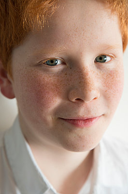 Boy with red hair and freckles, portrait - p623m1132220f by Frederic Cirou