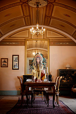 Woman with indian headdress in a castle - p1105m2245468 by Virginie Plauchut