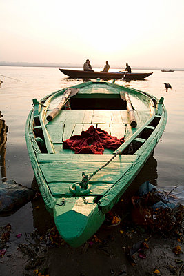 Ganges River, Varanasi, India; Green stationary boat at water's edge - p4429141 by David DuChemin