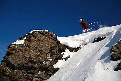 Skier going downhill, Abisko, Lapland, Sweden. - p5755293f by Hakan Hjort