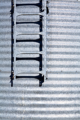 Ladder on Silo - p1100m2090853 by Mint Images