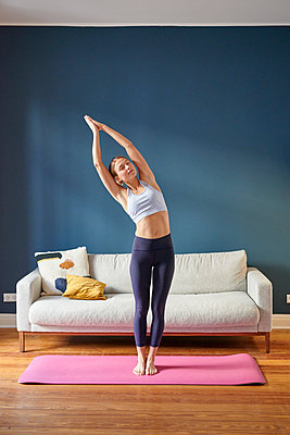 Young woman practicing yoga - p1124m1589406 by Willing-Holtz