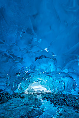 A stream flows beneath an ice cave on Mendenhall Glacier, Tongass National Forest; Alaska, United States of America - p442m2091956 by John Hyde