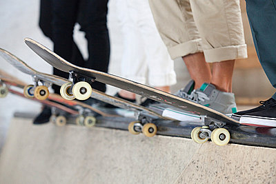 Skaters and their boards - p9245192f by Image Source