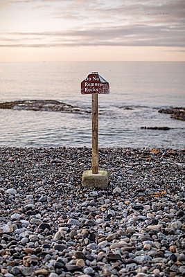 do not remove rocks sign at Seawall Beach Acadia National Park, Maine - p1166m2192041 by Cavan Images