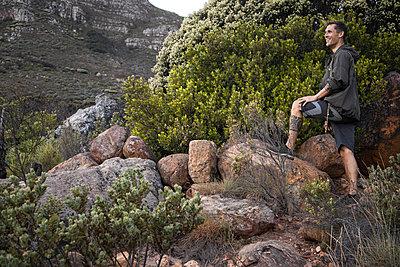 Hiker looking at mountain range - p1640m2261044 by Holly & John