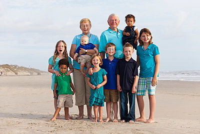 Happy multi-generation family enjoying beach together - p555m1479959 by Roberto Westbrook